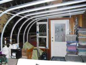 sunroom in disaray used as packing area