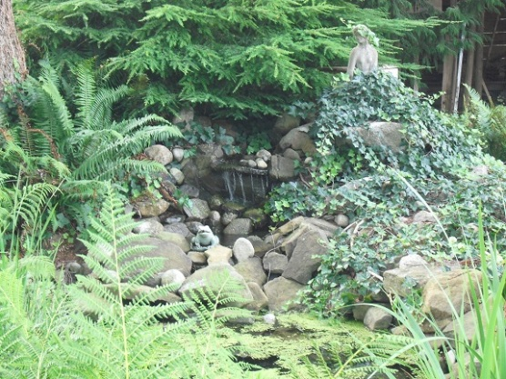 Private waterfall pond on property for sale